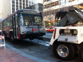 SF Muni bus towed