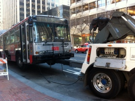 SF Muni bus towed