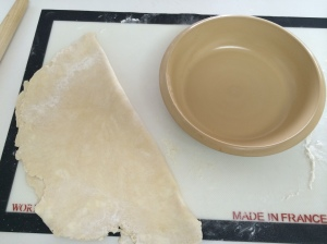 Folded in half, the round is ready for the dish.