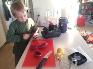 Kieran enjoyed scooping out the guts of the fruit.