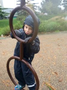 Testing playground equipment.